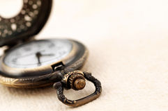 Pocket watch on vintage paper Stock Photo