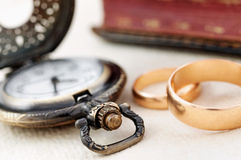 Pocket watch and wedding rings Royalty Free Stock Image