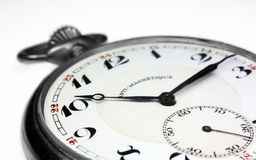 Old swiss pocket watch isolated very close up Royalty Free Stock Photo