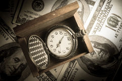 Pocket watch in wood box on money. Royalty Free Stock Photos