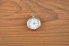 Pocket watch on wood Stock Images