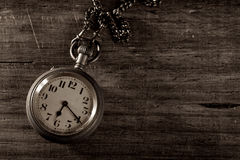 Pocket watch on wood Stock Photo