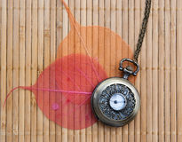 Pocket watch on a wooden mat Royalty Free Stock Image