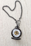 Pocket watch on  wooden table Stock Photo