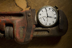 Pocket Watch in Wrench Stock Photography