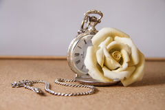 Pocket watch and a yellow rose Stock Image