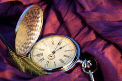 Pocket watches. And spikelets on the cloth background Royalty Free Stock Photography