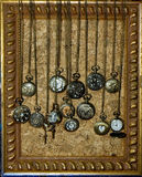 Pocket watches on brass chains Stock Image