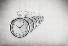 Pocket watches in a chain are in the line. Concrete background. Stock Images