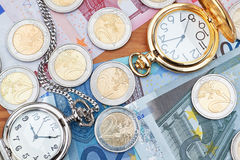 Pocket watches and euro. Royalty Free Stock Photography
