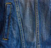 Pocket of a worn denim jacket. He pocket of the jacket is large-sized on a denim women`s jacket Royalty Free Stock Photos