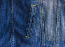 Pocket of a worn denim jacket. The pocket of the jacket is large-sized on a denim women`s jacket Royalty Free Stock Photos