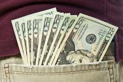 Pocketful av pengar Royaltyfria Bilder