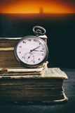 Pocketwatch and books Royalty Free Stock Image