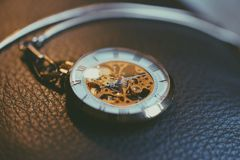 Pocketwatch on leather Stock Image
