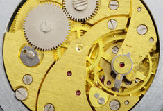 Pocketwatch  mechanism. Close-up of pocketwatch  mechanism with gears Stock Photo