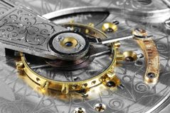 Pocketwatch Schwerpunktrad Stockbild