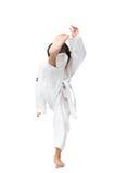 Poco arte marcial del muchacho del Taekwondo en el fondo blanco Imagen de archivo