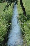 Poco canal del agua Imagen de archivo libre de regalías