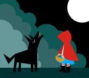 Poco capo motor de montar a caballo rojo y el lobo Fotos de archivo libres de regalías