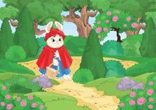 Poco cappuccio di guida rosso nella foresta immagini stock libere da diritti