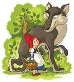 Poco cappuccio e lupo di guida rosso nella foresta Fotografia Stock