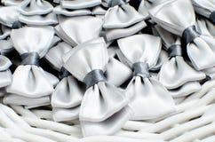 Poco lazos grises como decoración Foto de archivo libre de regalías