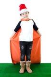 Poco muchacho asiático de la sonrisa con el sombrero de santa Fotografía de archivo libre de regalías