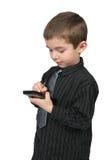 Poco uomo di affari che usando PDA fotografia stock libera da diritti