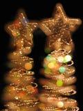 Pocos árboles de Navidad con las estrellas Foto de archivo