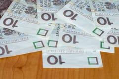 Pocos 10 billetes de banco de PLN Zloty polaco 10 Fotografía de archivo libre de regalías