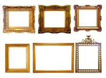 Pocos doraron marcos. Aislado sobre el fondo blanco Foto de archivo libre de regalías
