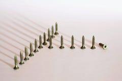 Pocos tornillos en la madera Fotografía de archivo