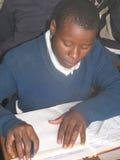 Początkowy uczennicy writing w klasie Zdjęcia Royalty Free