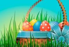 Pocztówka z Wielkanocnymi jajkami w łozinowym koszu w zielonej trawie Błękitny łęk z dekoracyjnym faborkiem ilustracji