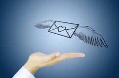 Poczta z anioła skrzydłem na Ludzkiej ręce Zdjęcie Royalty Free