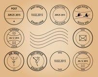Poczta znaczki na starzejącym się tle Obrazy Stock