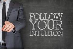 Podąża twój intuicję na blackboard z Obrazy Stock