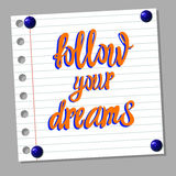 ` Podąża twój sen ` kaligraficznych ręcznie pisany listy na notatka papieru tle Obrazy Royalty Free