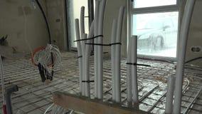 Podłogowego ogrzewania drymby i elektryczność druty przy budową zbiory