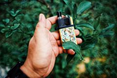 """New Vape pod system for quitting smoking habit alternative on hands. POD or """"ultra-portable systems"""" are essentially the middle-ground between your royalty free stock image"""