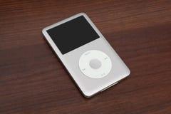 Pod classic 160 Gb. Pavlograd, Ukraine - December 4, 2014: iPod classic 160 Gb. Studio shot on wooden background Stock Photos