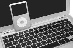 Pod classic 160 Gb on silver laptop. Pavlograd, Ukraine - December 4, 2014: iPod classic 160 Gb on silver metal laptop. Studio shot, isolated on white background Stock Image