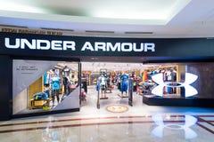 Pod zbroja sklepem w Suria KLCC centrum handlowym, Kuala Lumpur Obraz Royalty Free