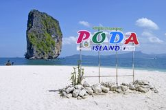 Poda island information sign. With the famous Ko Ma Tang Ming rock in the background, in the Andaman Sea, off Ao Nang, province of Krabi, Thailand stock photo