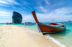 Poda Island Wooden boat parked on the sea, white beach on a clear blue sky, blue sea stock photos