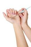 podaj opieki ciała paznokcie poleruje kobiety Zdjęcie Royalty Free