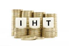 IHT (podatek spadkowy) na złocistych monetach na białym backg Obraz Stock