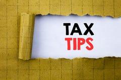 Podatek porady Biznesowy pojęcie dla porady Forn podatków pisać na białym papierze na kolorze żółtym składał papier Fotografia Stock