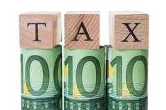 Podatków bloki Układający Na Staczać się Euro notatkach Zdjęcia Royalty Free